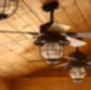 Ceiling fan in a wooden cabin.jpg
