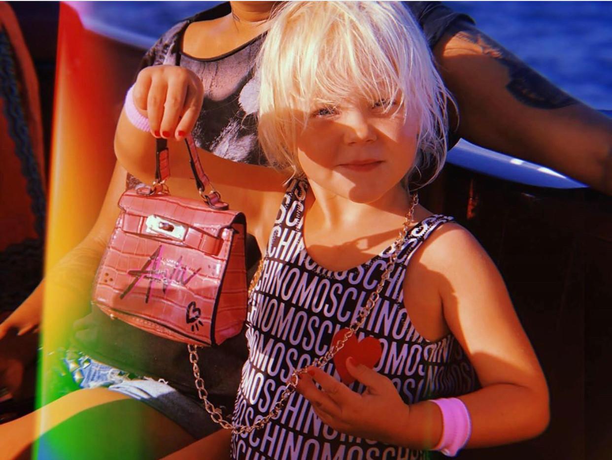 Ava with customized mini Hermes