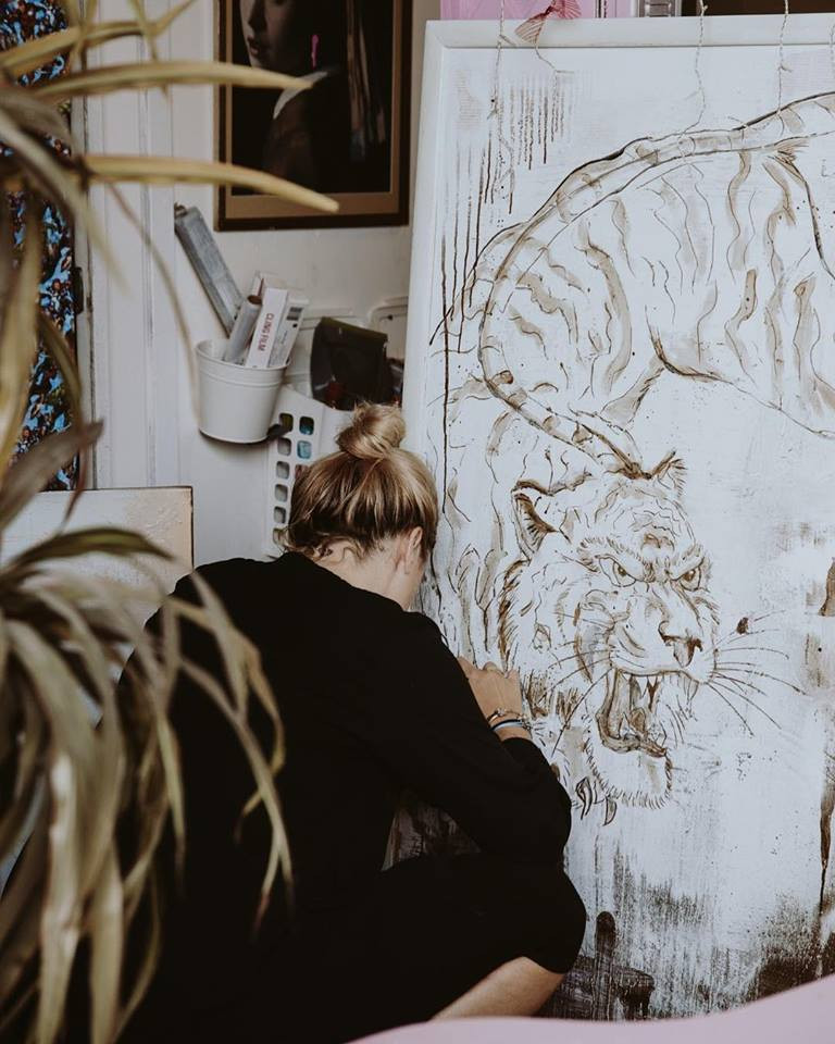 """Working on a large """"Gold Tiger"""" painting"""
