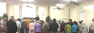 Troy praying with Congregation May 27 20