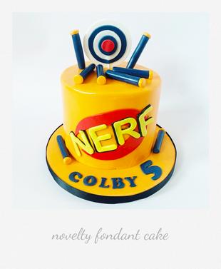 nerf themed fondant cake.png