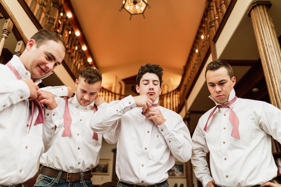 Groomsmen getting ready for their Banff wedding