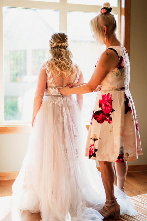 Mother of the bride helping with the dress during Cornerstone Theatre wedding