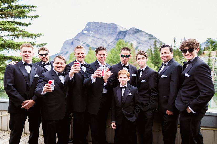 Groom and groomsmen posing for their Banff wedding photographer