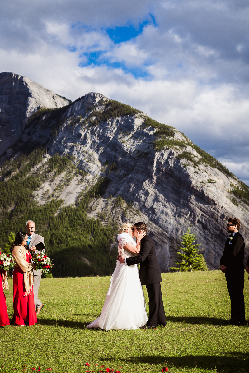 First kiss at Tunnel Mountain wedding in Banff