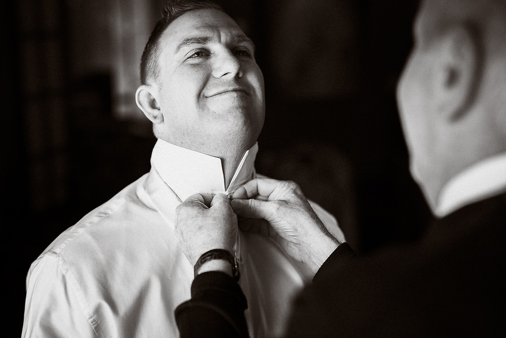 Groom getting ready during his winter wedding at Emerald Lake