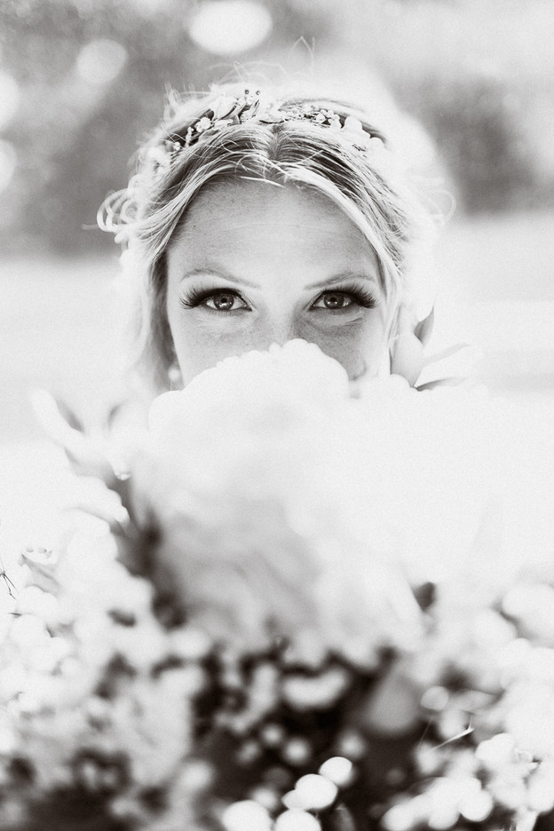 Bridal portrait eyes and flowers black and white by Canmore wedding photographer