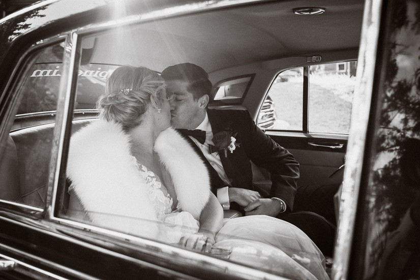 A kiss in the Rolls Royce limo leaving Tunnel Mountain Banff
