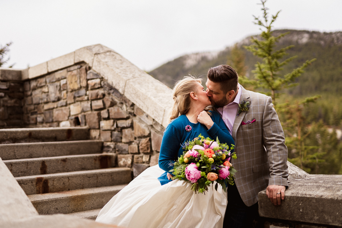 A sweet kiss for this bride and groom at their Fairmont Banff Springs Hotel elopement