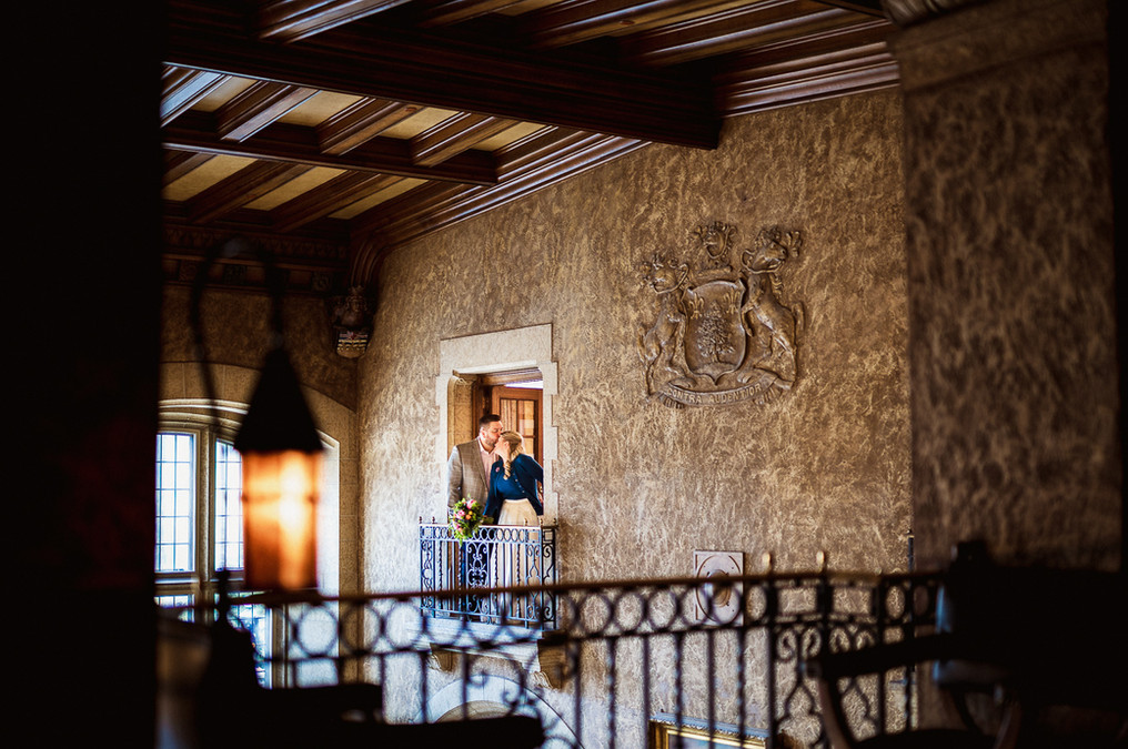 Creative portrait of bride and groom above the Alhambra room