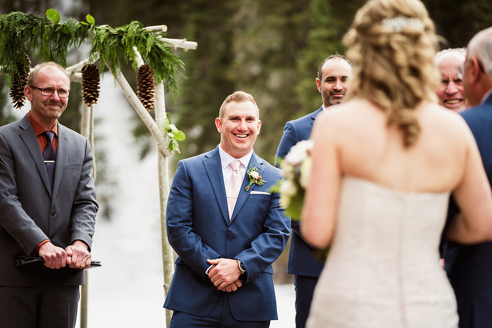 Bride and groom seeing each other for the first time at their Emerald Lake wedding