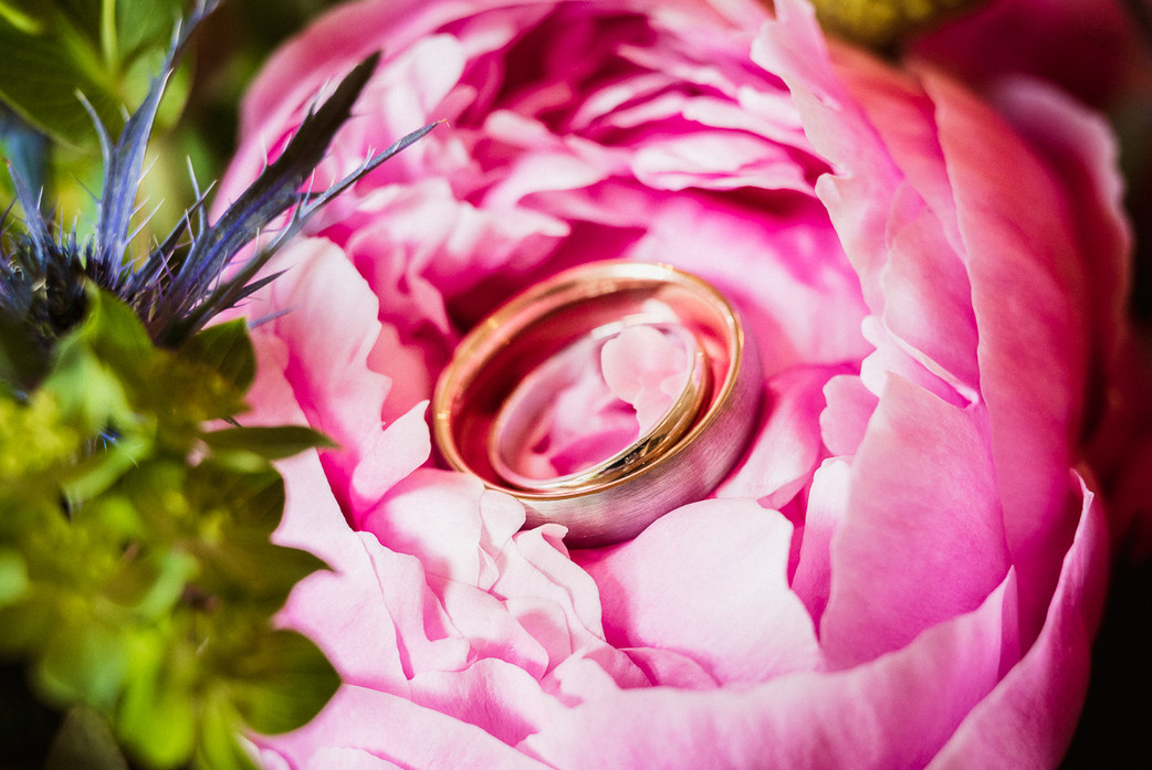 Ring placed in flowers during intimate elopement in Banff