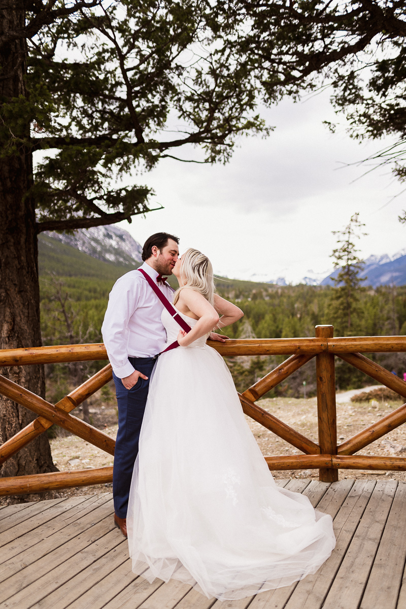 Funny moment during this Banff elopement photography at Surprise Corner