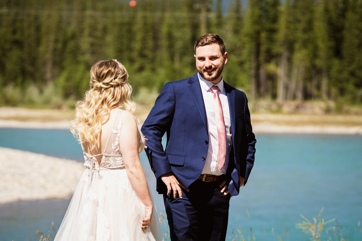 Grooms reaction during first look at Canmore Engine Bridge