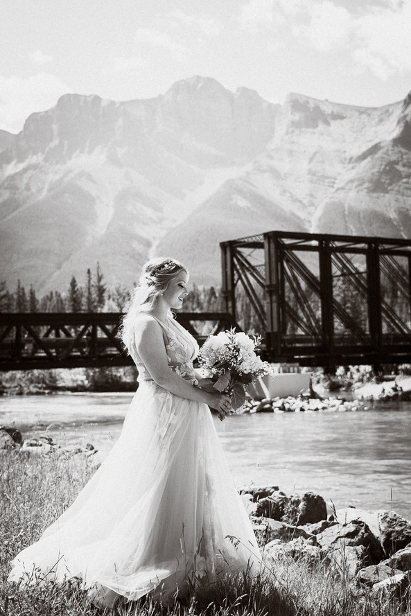 Intimate black and white bridal portrait at Canmore Engine Bridge