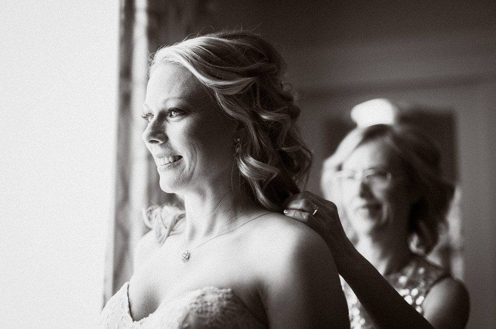Candid moment bride and mother by Emerald Lake wedding photographer