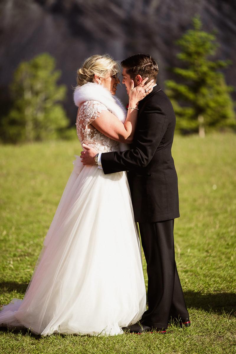 Banff wedding photographer at Tunnel Mountain wedding first kiss