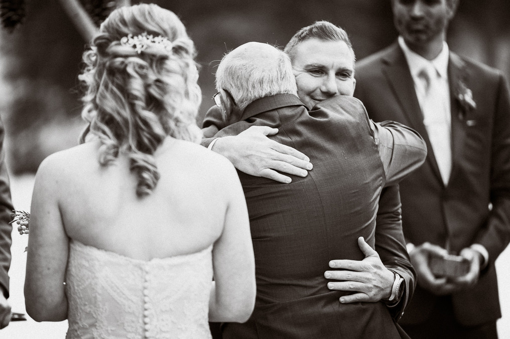 Candid moment during wedding ceremony by Emerald Lake wedding photographer