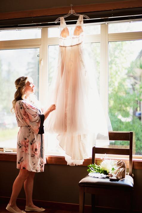 Bride look at dress before her Cornerstone Theatre wedding