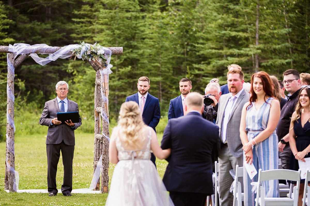 Bride walking down the aisle during ceremony at Canmore Ranch