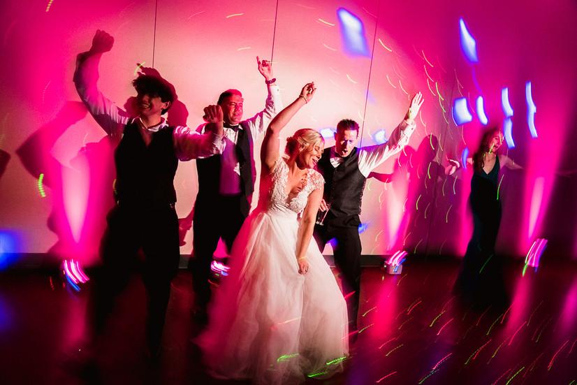 Bride dancing at Banff Park Lodge wedding reception