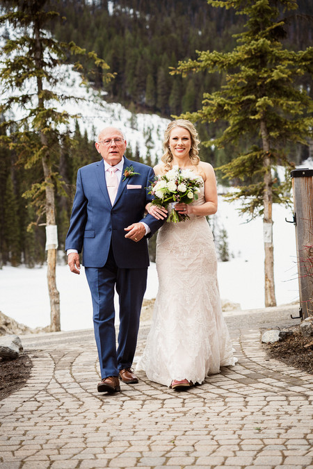 Emerald Lake wedding ceremony with bride walking down the aisle