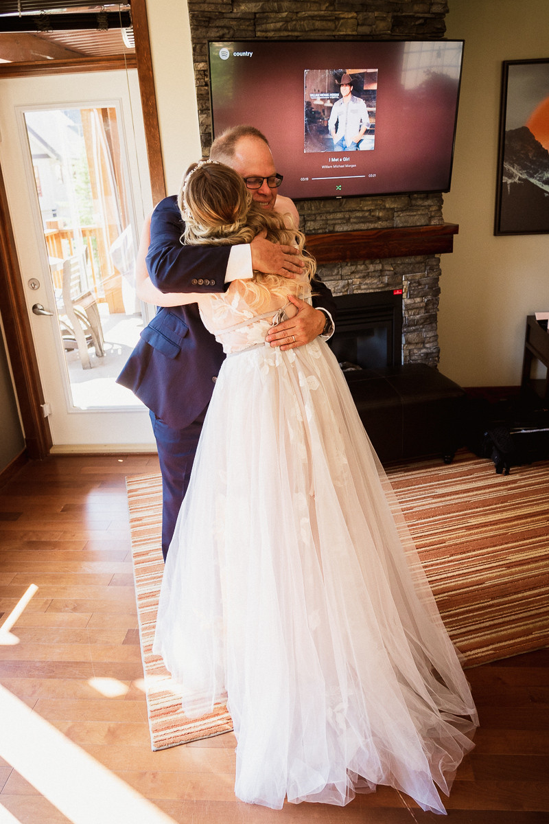 Emotional first look with bride's father at Cornerstone Theatre wedding