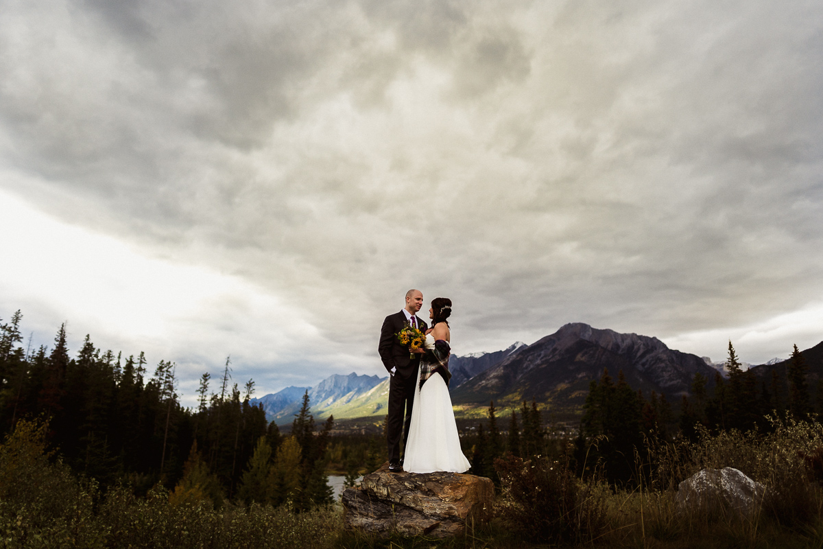 Dramatic skies at this Fall Canmore elopement photography