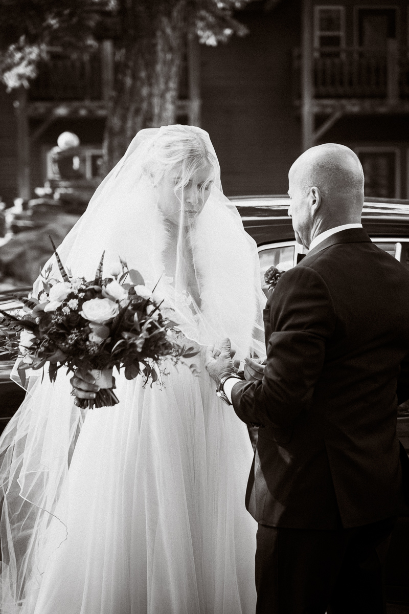 Candid moment between father and bride during Tunnel Mountain wedding