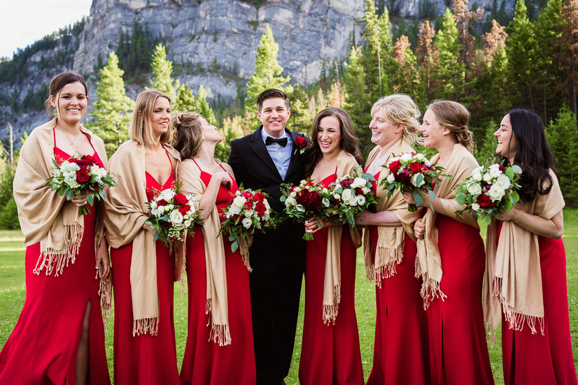 Groom and bridesmaids having fun at Tunnel Mountain in Banff