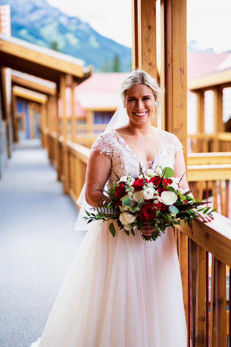 Banff wedding photographer taking bridal portrait at Banff Park Lodge