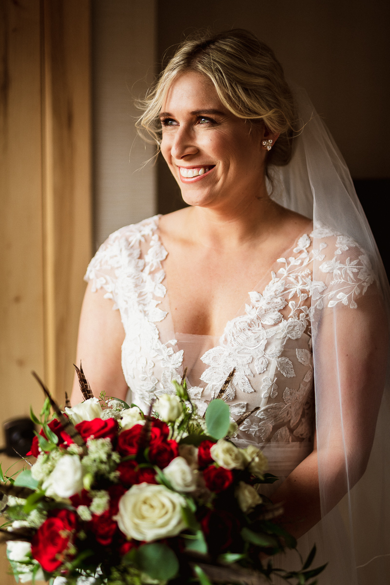Bride poses for Banff wedding photographer