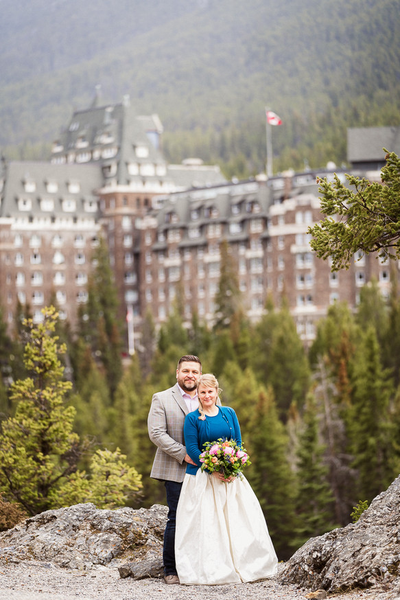 A tender embrace during Banff elopement photography at Surprise Corner