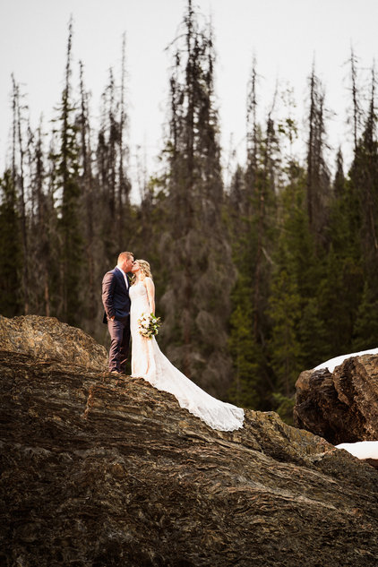 Emerald Lake wedding photographer at Natural Bridge with bride and groom