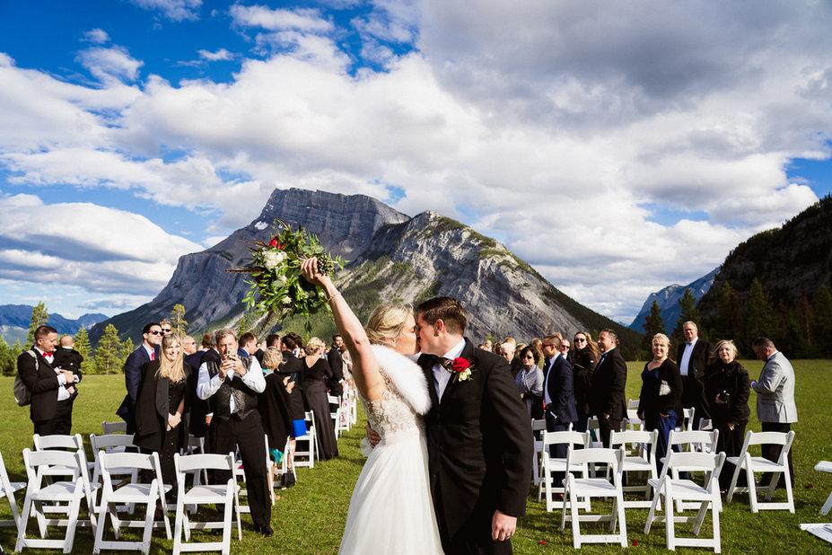 Banff wedding photographer at Tunnel Mountain Reservoir first kiss
