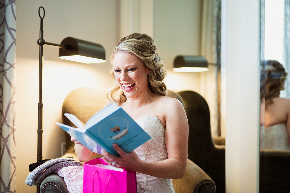 Bride opening gift during her Emerald Lake wedding photography