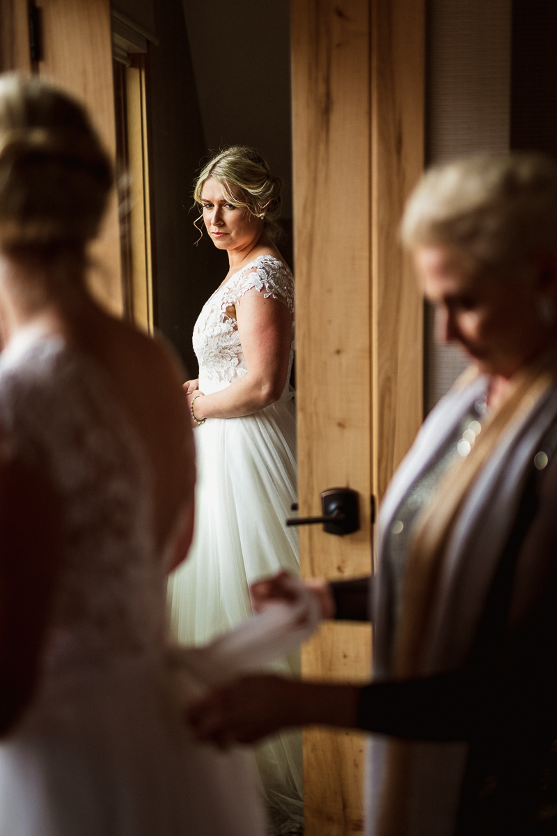 Mother helping bride get ready for their Banff Park Lodge wedding