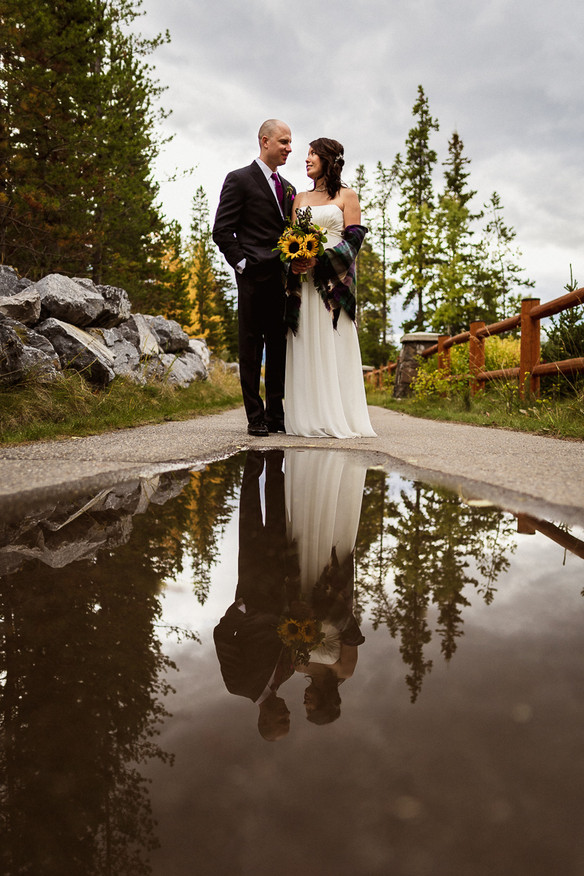 Reflection in puddle by Canmore elopement photographer at A Bear and Bison Inn wedding