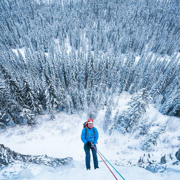Alex Popov Photography rapelling after completing an ice climb in Canmore