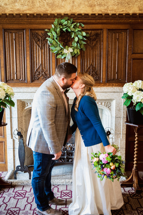 First kiss in Strathcona room at Fairmont Banff Springs Hotel elopement