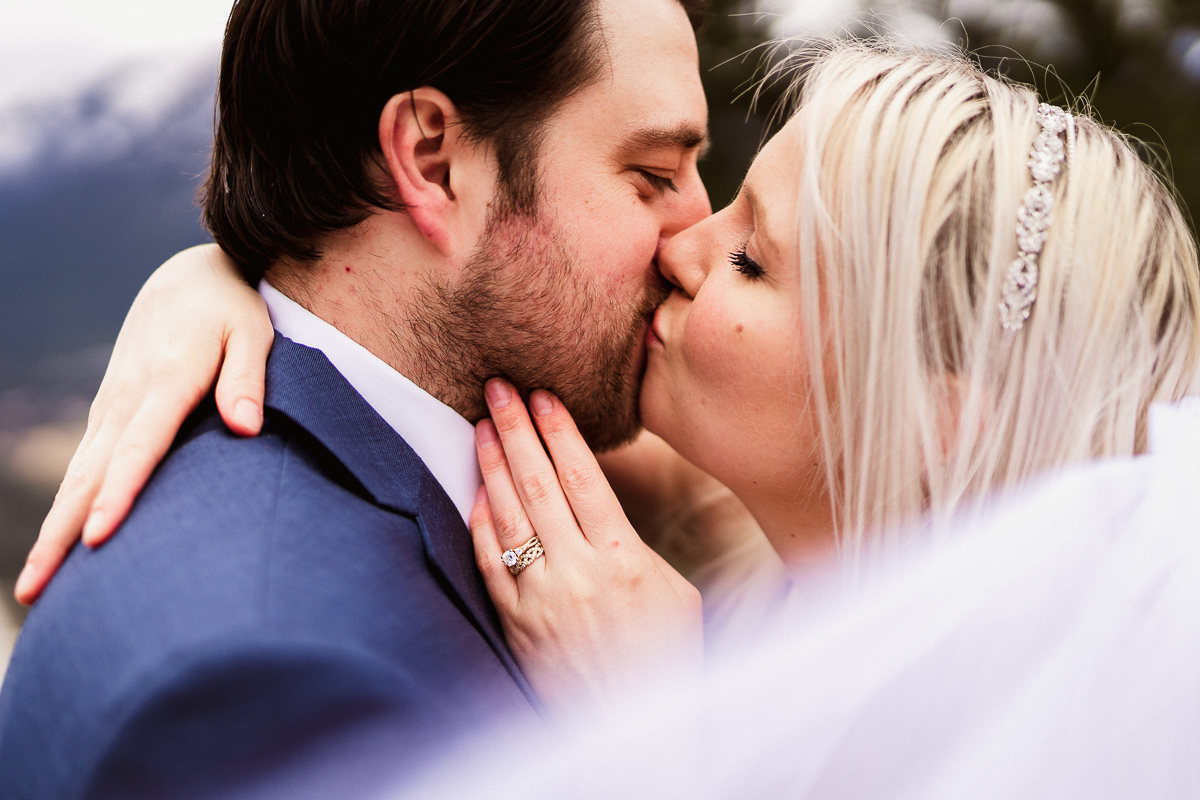 Intimate kiss during outdoor Banff elopement photography