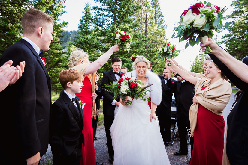 Bride and groom grand exit in Banff