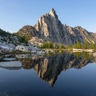 Prusik Peak in Washington reflecting in an alpine lake
