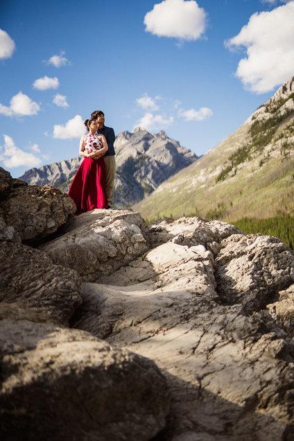 Hiking engagement photos in Banff National Park at Lake Minnewanka