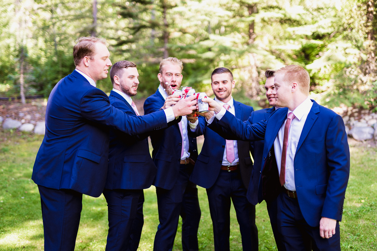 Canmore wedding photographer with groomsmen drinking