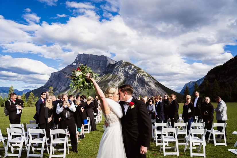 Celebrating with a first kiss at their Tunnel Mountain wedding in Banff