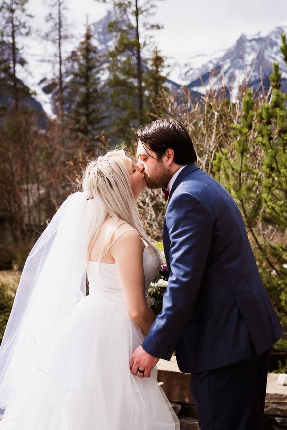 First kiss during Banff elopement photography