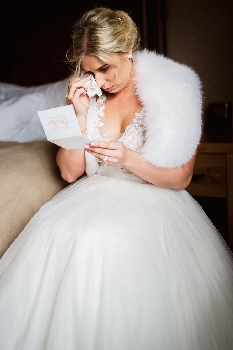 Tears of happiness as bride reads letter from husband on wedding day