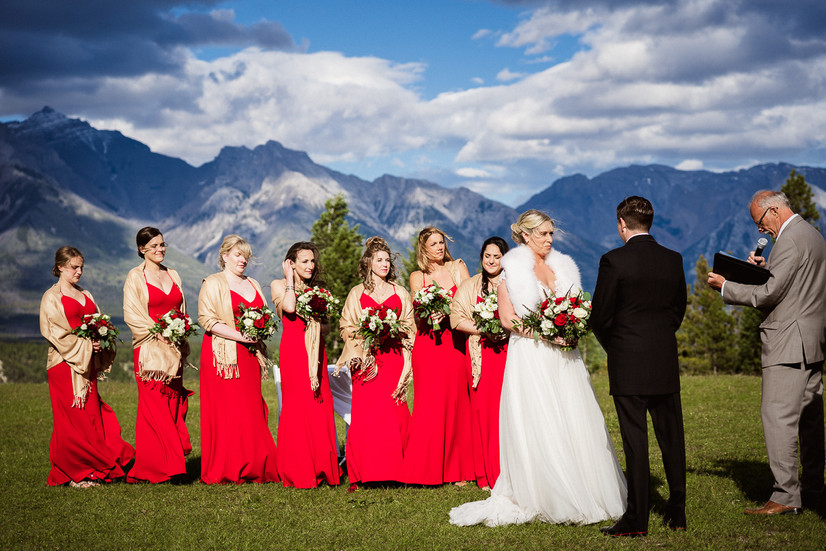 Bride and groom at Tunnel Mountain wedding with moody dark sky