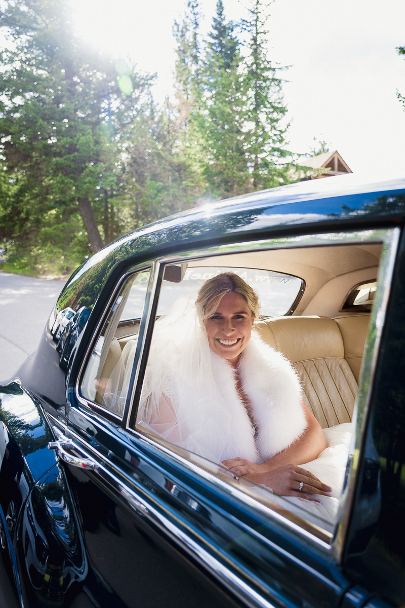 Bride arriving in Alpine Limo Rolls Royce for Tunnel Mountain wedding